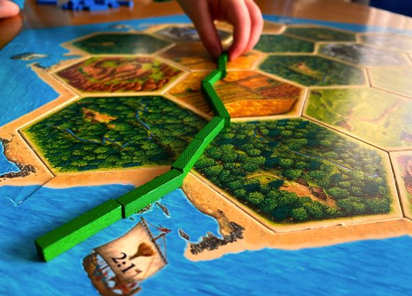 Four Fun Modifications of Catan That Work with Young Kids 🪵 🧱